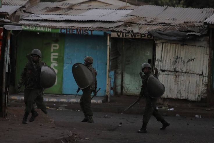 Kenyan police officers take position to disperse angry supporters of the opposition leader Raila Odinga during an unrest in Kibera after the results of the controversial repeat presidential polls were announced by the Electoral Commission on October 30th 2017. Photo by Bryan Jaybee @storitellah #KiberaStories