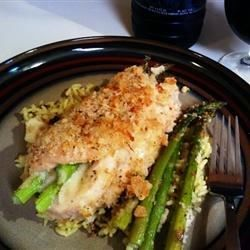 Skinless, boneless chicken breasts are pounded thin, rolled around fresh spears of asparagus with mozzarella cheese, and baked for an easy spring dinner that's ready in less than an hour.