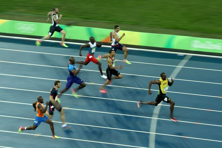 Usain Bolt Photos Photos - Usain Bolt of Jamaica competes on his way to winning the Men's 200m Final on Day 13 of the Rio 2016 Olympic Games at the Olympic Stadium on August 18, 2016 in Rio de Janeiro, Brazil. - Decathalon - Olympics: Day 13