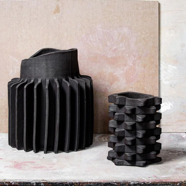 Black vs black large Sprocket Vase with a small '70 Vase. Photo made by…