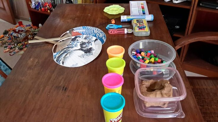 Clay, colorful plasticy, playdoh, art corner and fan. Also bubbles. Kids love bubbles.