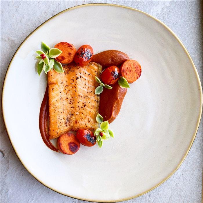 Salmon belly, guajillo chili & mamey sapote purée, blistered tomatoes, pork fat fried mamey sapote.