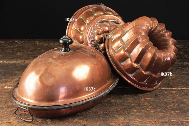 Beautiful old copper moulds and warming pan.
