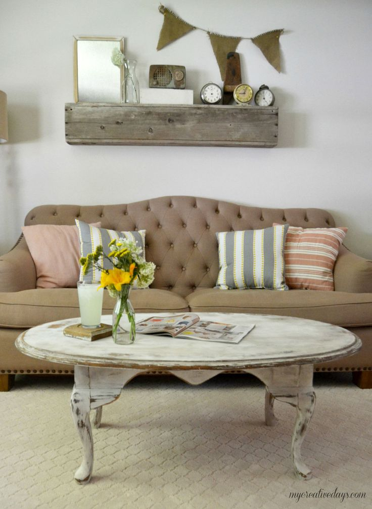 This coffee table was transformed to have a more rustic feel by heavy distressing using two coats of white paint and then sanding.