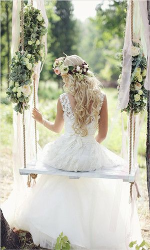 The dress, the florals, the swing - such a warm, 'feel good' factor -could be the perfect wedding scenario...