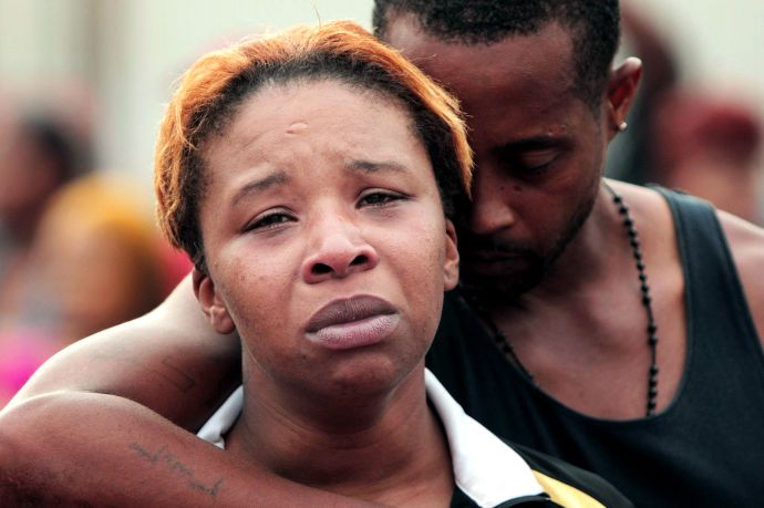 Why Did Michael Brown Die in Ferguson? - The New Yorker...Lesley McSpadden and Louis Head, the mother and stepfather of Michael Brown, on August 9th.
