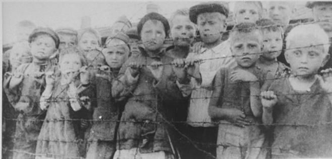 Children at  German concentration camp inside Russia wait solemnly for liberation.