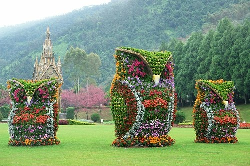 "These owl sculptures are located in Taiwan near ""Sun Moon Lake"".  in a garden named ""Formosan Aboriginal Culture Village"""
