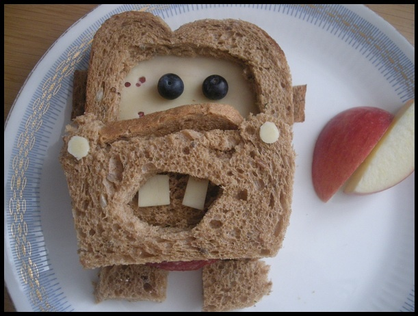 """I made my kids Disney Cars """"Tow mater"""" sandwiches for lunch today. They loved it... (now they're in therapy)."""