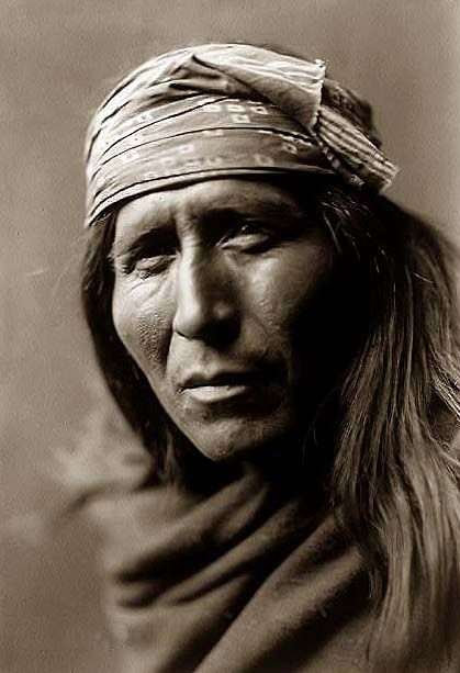 You are viewing an unusual image of Tsahizn Tseh. It was taken in 1906 by Edward S. Curtis.    The image shows Tsahizn Tseh, an Apache Man, bust portrait, facing front, with a bandana covering his head.