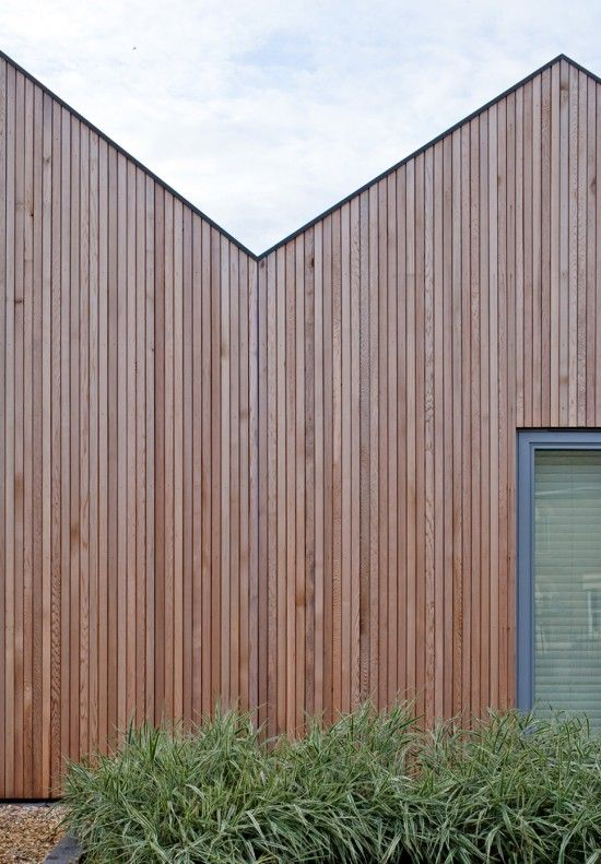 Home has four consecutive roof pitches clad in vertical Siberian larch; Mole Architects