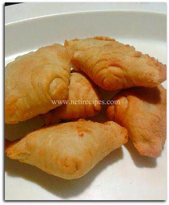 Karipap, malay snack from pastry dough with veggie stuffing. Yummy and easy to make it at home.  For complete recipe please visit www.netirecipes.com