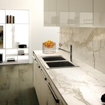 Calacatta ThinSlab Porcelain - marble-look slabs. doesn't require sealing and doesn't stain.  Comes in polish or honed finish