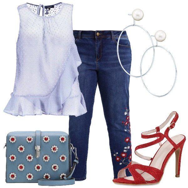 Capo versatile ed indispensabile il jeans, qui scelto in un modello a vita alta, gamba stretta, lunghezza alla caviglia, impreziosito da ricami floreali, abbinato a top grigio, in tessuto leggero in fantasia a pois scollo tondo, volant. Sandalo rosso, in tessuto, cinturino alla caviglia, tacco a spillo, borsa a tracolla azzurra, chiusa con gancio, applicazioni in pietre, orecchini a cerchio con perla bianca.