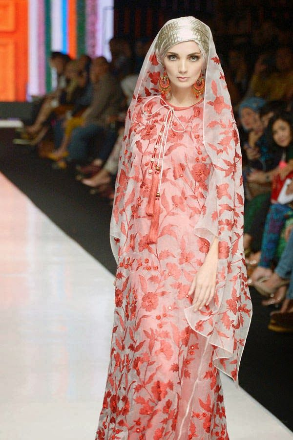 A model displaying Muslim themed creations by Indonesian designer Itang Yunasz during Jakarta Fashion Week in Jakarta.