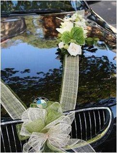 Inspiring Wedding Car Decorations; using the tulle ribbon helps keep costs in check.: