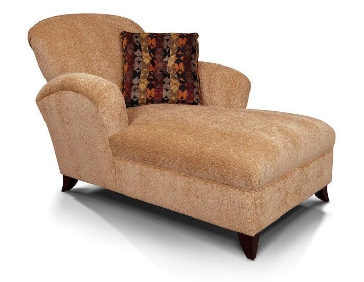 This exclusive contemporary chaise offers contoured arms and a clean tight-seat cushion construction. An extra large throw pillow, adorned with a jumbo-size square button, accents the comfortable lounger.