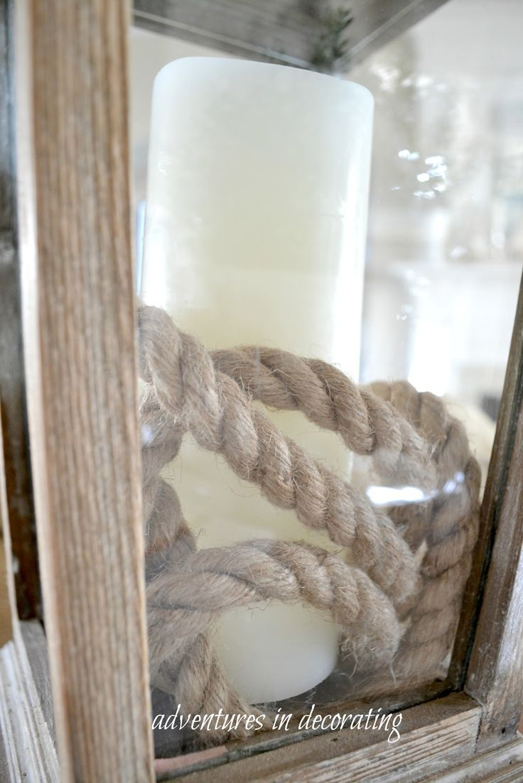 Nautical rope around candle in lantern. Cheap cute nautical  table centerpiece. You could use white Luminara candles for a few dollars more. :)