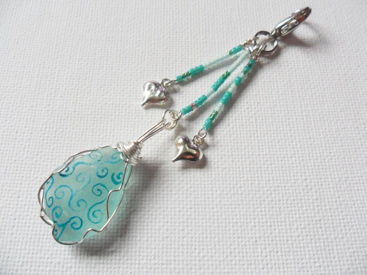 Seafoam swirl and dangle silver heart sea glass bag charm by ShePaintsSeaglass on Etsy