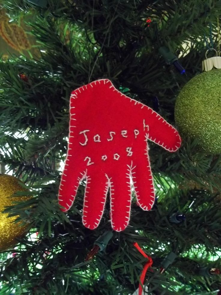 felt handprint ornament- maybe do a white handprint on a red circle