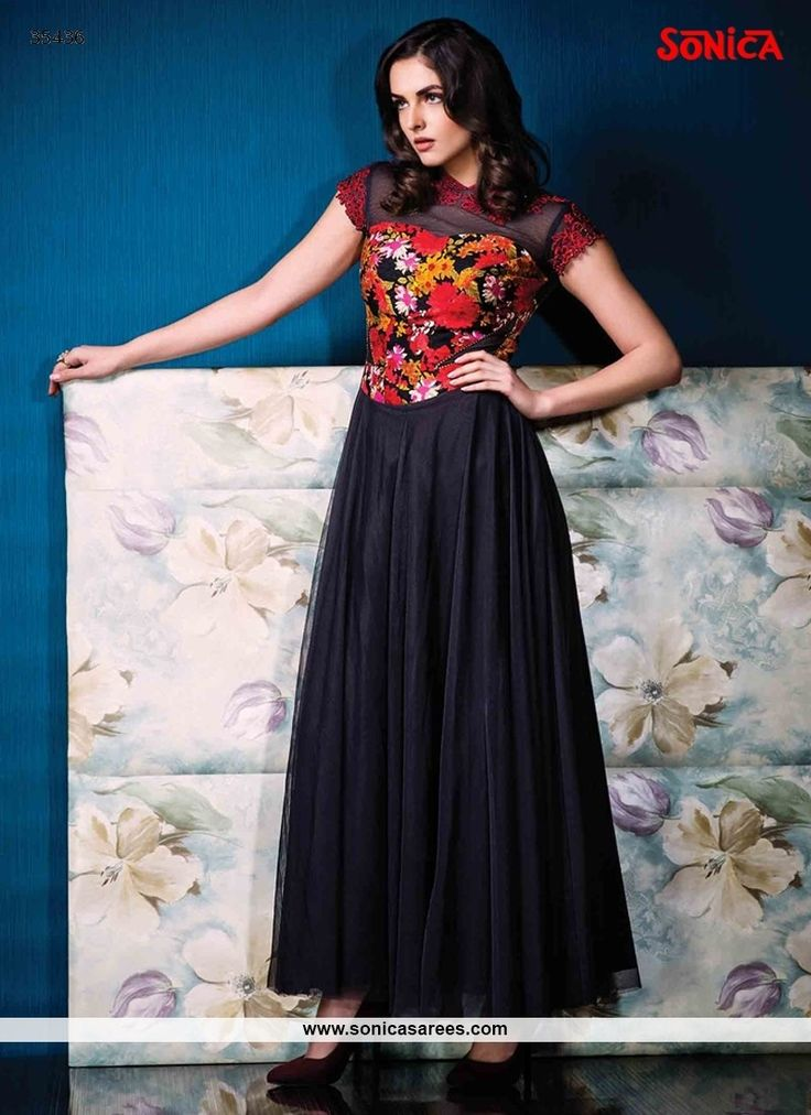 Add richer looks to a personality with this dazzling multi colour net and raw silk designer gown. The print work on dress personifies the overall look. (Slight variation in color, fabric & work is pos...