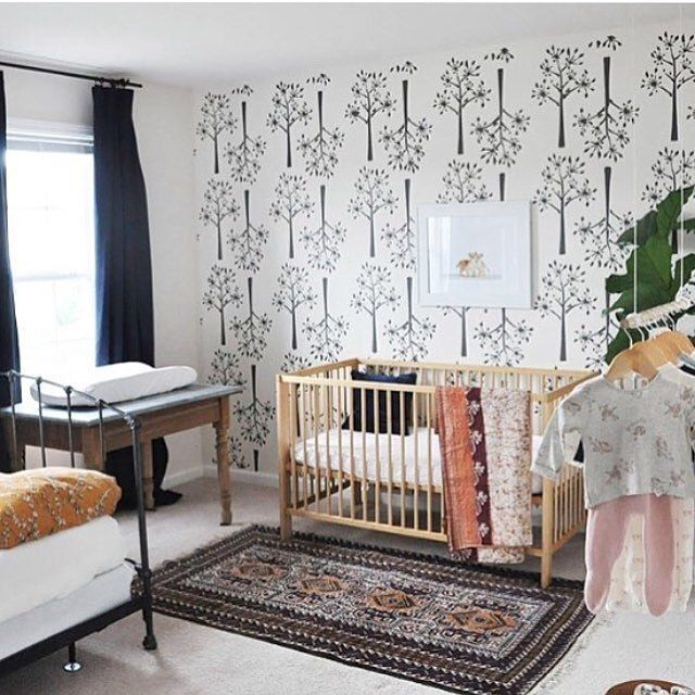 This stenciled wall adds a really fun pop of pattern in this sweet nursery. Image by @restlessoasis