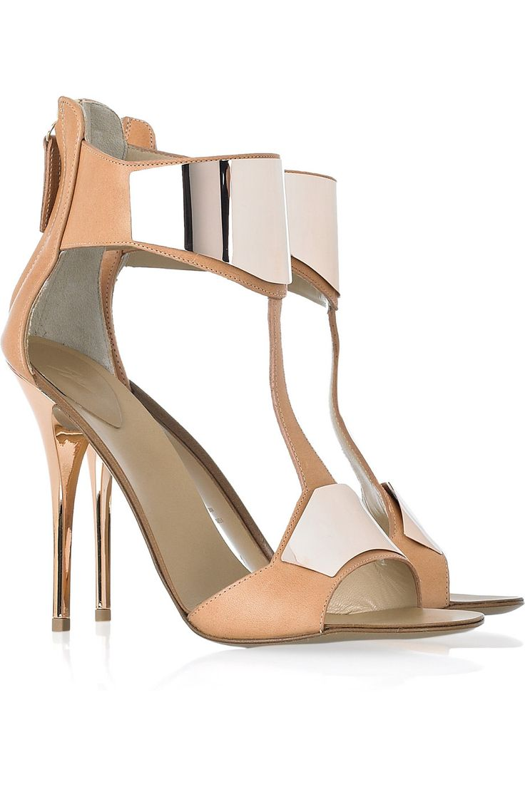Apricot leather Tbar sandals with a metal stiletto heel that measures approximately inches Giuseppe Zanotti sandals have an open toe bronze metal plates