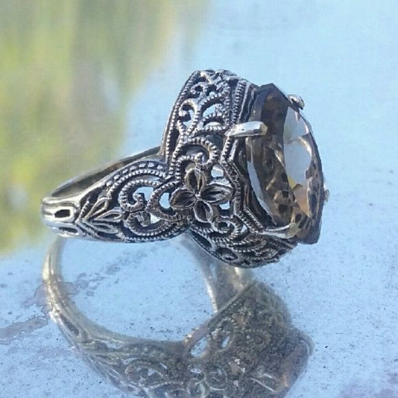 LAST CHANCE Art Deco Sterling Smoky Topaz Ring What a beautiful ornate solid sterling silver filigree ring fashioned with a marquis cut Smoky Topaz gemstone.  QVC. So it's more than  likely  designer. And has a CNA mark. It's too small for me. Size 6.5 -7. CNA Jewelry Rings