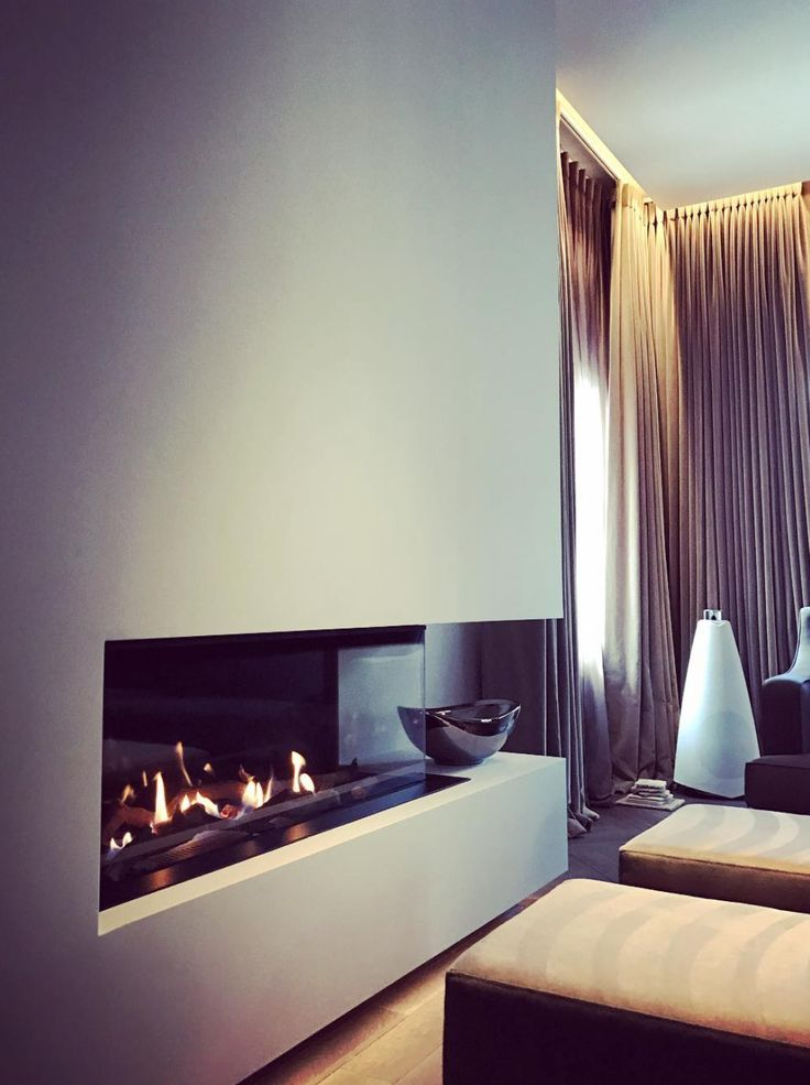 Stylish Bang & Olufsen interior featuring BeoLab 20, with a stunning fireplace design and elegant curtains, shared by Janey Butler Interiors on Instagram!