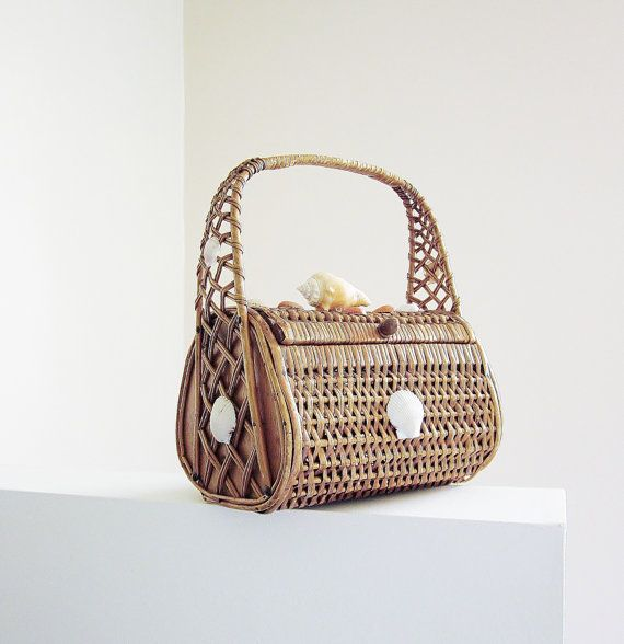 Hey, I found this really awesome Etsy listing at http://www.etsy.com/listing/154925054/rattan-wicker-seashell-basket-purse