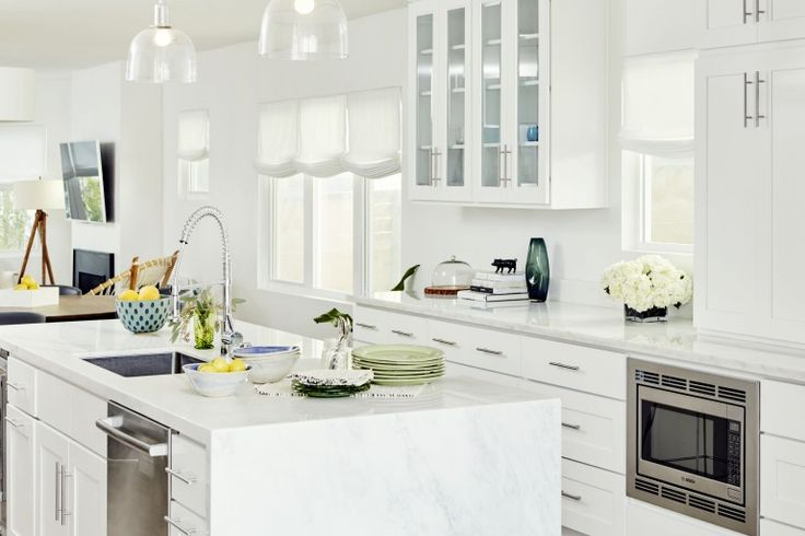 An all white kitchen. We love Damsel In Dior's new digs!