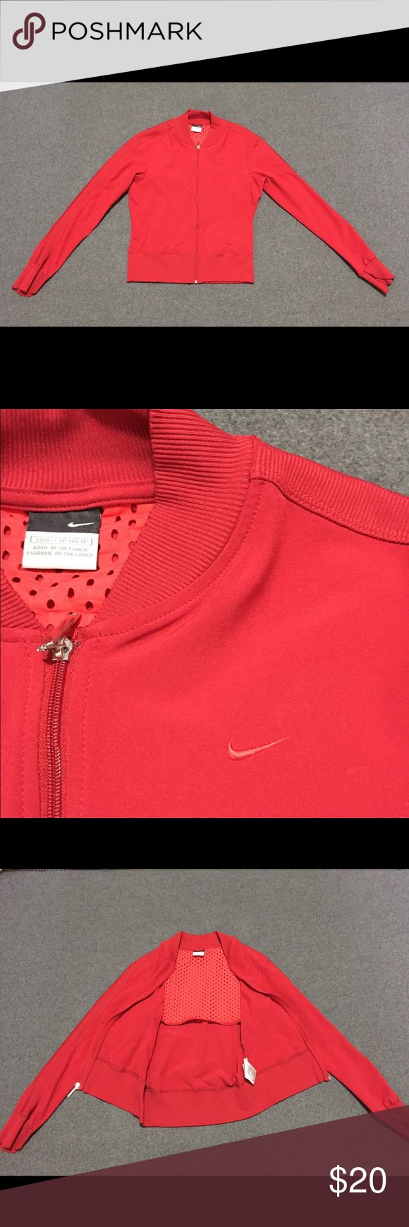Lightweight Nike Jacket This red Nike jacket is the perfect lightweight cover-up for any activity. It has light mesh lining on upper-back, pockets, and unique cuff detail (shown in picture). The polyester-spandex blend fabric allows some stretch which would be great for running, walking, tennis, etc. Cropped fit with elastic at waist for flattering fit. Some slight signs of wear along cuffs, but otherwise in good condition! Nike Jackets & Coats Utility Jackets