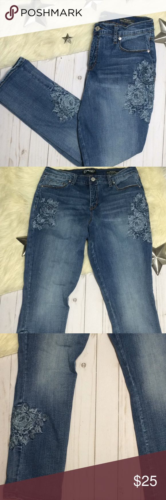 """Miraclebody jeans floral embroidery promise crop Miraclebody by miraclesuit jeans in their Promise wide cuff crop style. Extra slimming and stretchy. They have an embroidery rose design stitched in blue on the thighs and leg. Factory distressing and whiskering.  Great condition, but does have some light wear on the hems.  APPROX MEASUREMENTS Waist, laid flat: 15"""", lots of stretch Rise: 10"""" Inseam: 27.25"""" Miraclesuit Jeans Ankle & Cropped"""