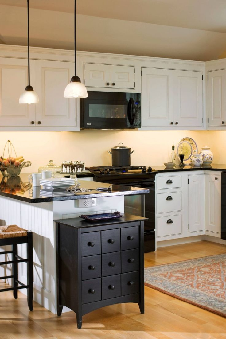 black appliances white cabinet black drawers black countertop ceiling lights area rug bar stool of Irresistible Kitchen with Black Appliances Ideas