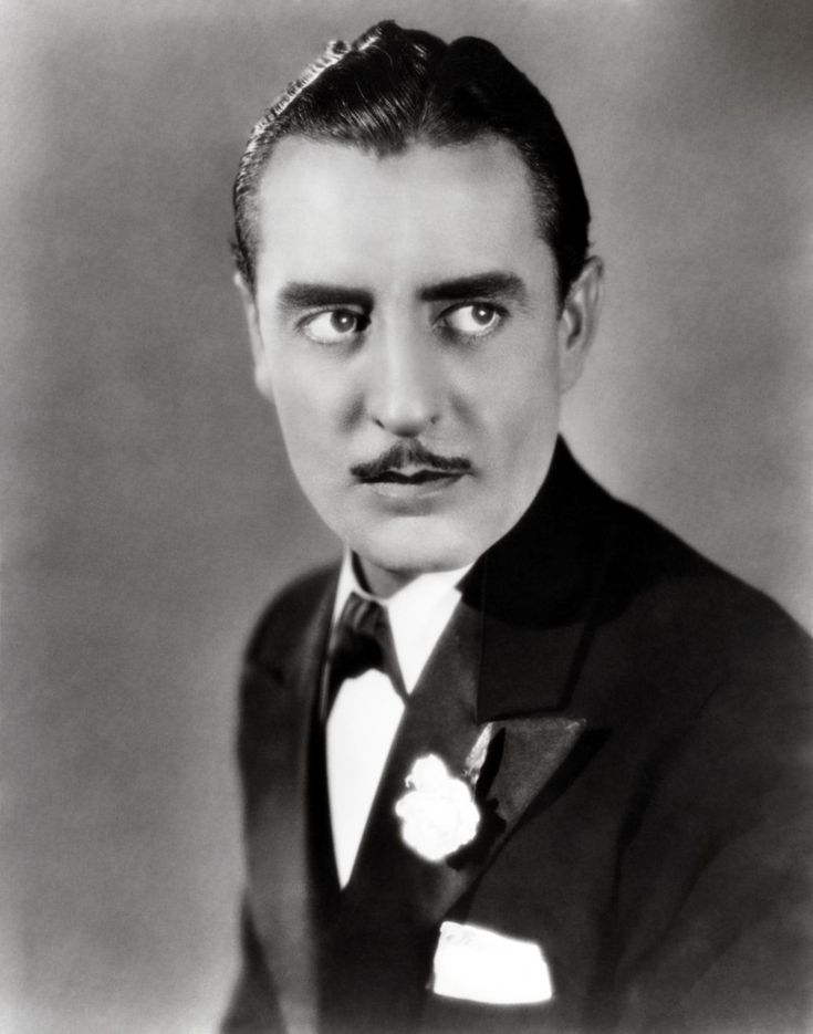 During the 1920s, men favored a clean shaven face or a small mustache. Here, actor John Gilbert sits for a photo.
