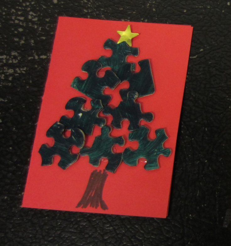 We painted the puzzle pieces (8 per tree) with green acrylic paint in advance (works best when the puzzle is assembled) and then the kids stuck them on with glue dots. The star is a sticker, and the trunk is drawn and colored with brown marker.