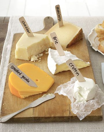 So simple! Use plain wooden or plastic stakes and a Sharpie to separate the Cheddar from the manchego at a party.
