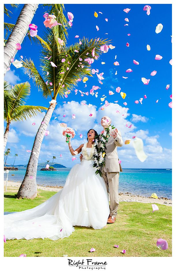 http://www.rightframe.net - Destination wedding on the beautiful Kahala Beach (Waialae Beach Park), Oahu.  Hawaii, photography, photographer, weddings, photos, bride, groom, hawaiian, romantic, ideas, couple, bouquets, lei, palm, tree, Waikiki, honolulu, resort,
