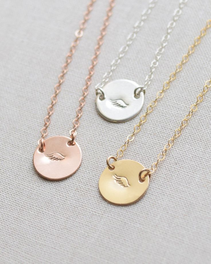 Godmother Necklace by Olive Yew. Show your Godmother how much she means to you with this tiny disk necklace that is stamped with an angel wing. Available in silver, gold or rose gold.
