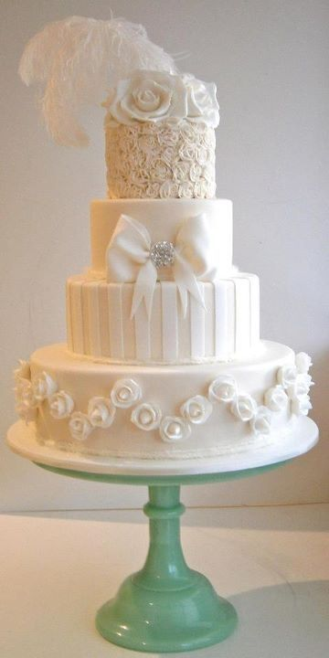 4 Tier White Cake with different details on each tier. Lovely!
