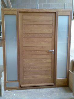 Modern Oak Front Door with opaque side screens.