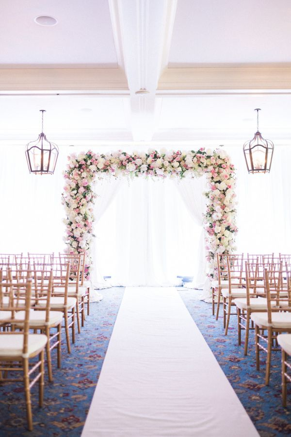 Gorgeous indoor floral arbor: http://www.stylemepretty.com/florida-weddings/naples-fl/2015/08/19/romantic-yacht-club-wedding/ | Photography: Hunter Ryan Photo - http://hunterryanphoto.com/