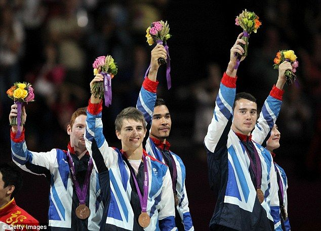 Bronze medalists Daniel Purvis, Max Whitlock, Louis Smith, Kristian Thomas and Sam Oldham on the podium - first medal for Great Britain in Olympic men's team gymnastics since 1912.