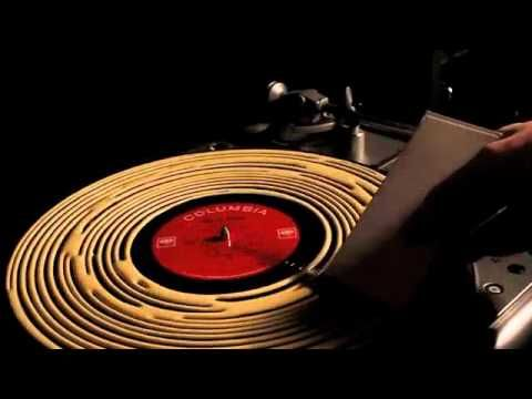 Cleaning and improving the sound of a Record with Wood Glue. Watch the video.