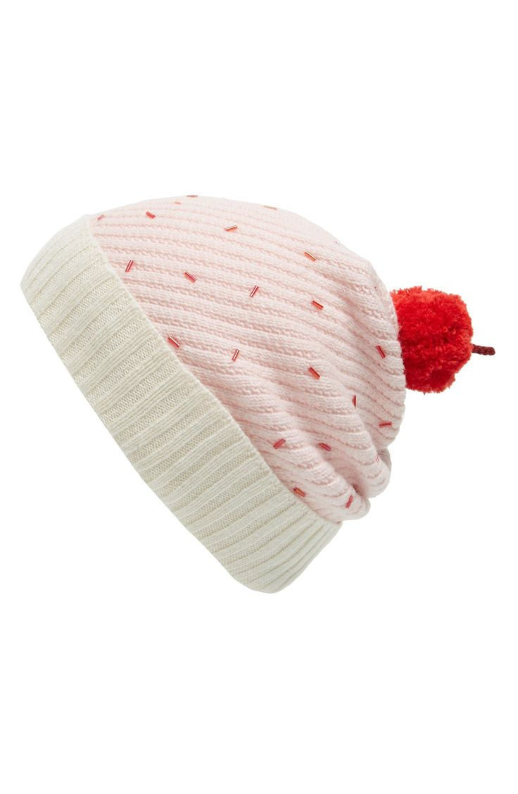 Crushing on this Kate Spade cupcake beanie that adds a sweet touch to the cold-weather look. A bright-red pompom is the cherry on top of this deliciously fun style.
