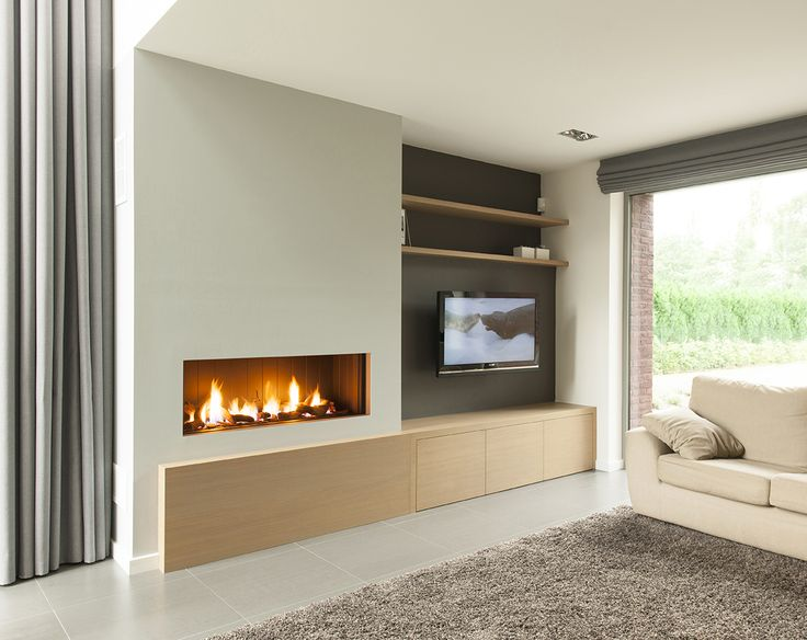 Gashaard in totaalwand met eiken kast legplank Gas fireplace in total wall with oak cabinet and shelf