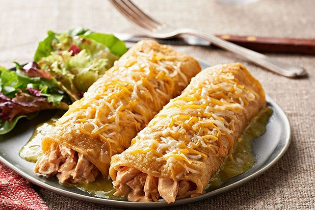 Bring a little spice to your weeknight mealtime with these Green Chicken Enchiladas. Smothered in salsa verde is the ideal way to enjoy this dish.