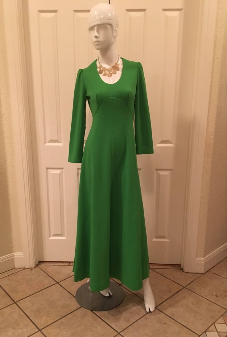 A personal favorite from my Etsy shop https://www.etsy.com/listing/566795738/vintage-maxi-dress-green-long-sleeve