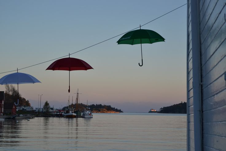 Umbrellas decorated in Lillesand. During the culture night in the idyllic town Lillesand in Southern Norway Photo: Elisabeth Høibo©Visit Southern Norway