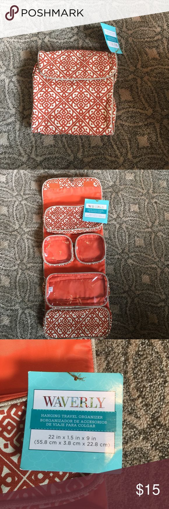 Waverly hanging travel organizer Beautiful orange and cream fabric travel organizer. One section is removable. All sections have zippers. Three are clear fronts. Waverly Bags Travel Bags